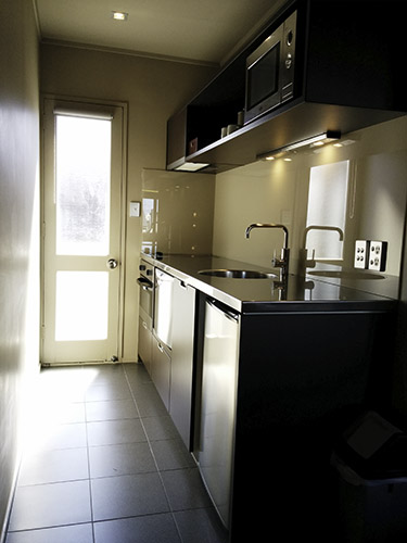 lovely kitchenette w/ fridge and sink