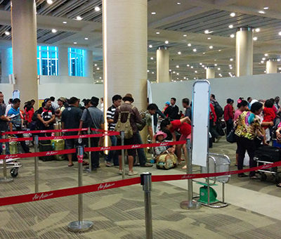 Indonesian airports love lines and little bits of paper
